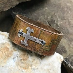 Cross and leather cuff